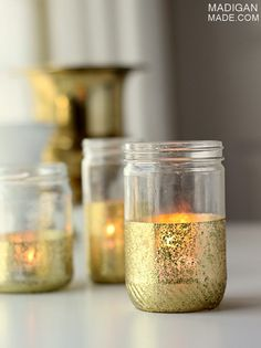 DIY: glitter and gold dipped mason jar candles for decorating or center pieces keep old peanut butter jars or pasta jars, upcycle your wedding, recycling, wedding decorations on a budget