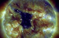 """A hole in the sun's atmosphere--a """"coronal hole""""--has opened up and it is spewing solar wind into space. Coronal holes are places where the sun's magnetic field spreads apart and allows solar wind to escape. A windy stream of plasma flowing from this particular hole should reach Earth on June 2-3."""