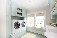 Great color and so much more attractive than the standard risers for washers and dryers. eclectic laundry room by Four Chairs Furniture