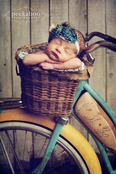 Vintage.  baby in bicycle basket