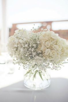 reception tables - babies breath and white hydrangea together. Could be nice having all white flowers in my tea pot centerpieces.