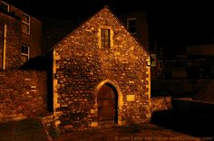 The Unique St Edmund's Chapel of Priory Road at Night, Dover, Kent, England, UK. Consecrated 1253 by St Richard of Chicester, dedicated to St Edmund of Abingdon. Dissolved 1544 under Tudor King Henry VIII. Dimensions: 28 feet by 14, walls 2 feet thick. Ex-Royal Navy victualling store, store room, blacksmith's forge, Toc H. Restored 1967-1968, Saturday morning Eucharists held every week. Grade II* Listed Building. Church, History, Travel and Tourism. See: http://www.panoramio.com/photo/46269565