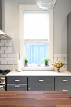 Yes Yes Yes. Dark Lowers. White Subway Tile with Dark Grout. Butcher Block Island. Thick Beefy Trim. I'm Drooling.