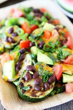 Grilled Zucchini Nachos -  Use what's in your garden plus add black beans and avocado. Yum!