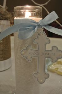 Pretty plain candle dressed up with a ribbon, white twine, and a cute hanging cross tag.  Perfect as Communion decorations or favors.