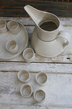 little white cups, a tray, and a textured porcelain pitcher by Laurie Goldstein #ceramics