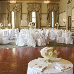 Wedding reception in the elegant Bourbon Orleans Hotel Orleans Ballroom featured white linens and floral arrangements. www.bourbonorleans.com