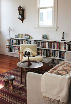 Love the books on low shelves stretched along one wall. Instead of bookshelves always being vertical. Perfect under wall with window.    sfgirlbybay / bohemian modern style from a san francisco girl / page 4
