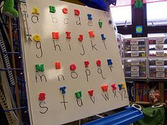 Match uppercase letter magnets to the lower case letters written on the board. Awesome!
