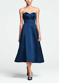 Anybridal party will gleam while capturing enchanting moments in this sensational tea length dress!  Strapless bodicefeatures sweetheart neckline that accentuates theneck and shoulders.  Dazzling intricate beading around the waist adds a touch of glam.  Full tea length skirt hits below the knee.  Imported. Back zip.Dry clean only.  Sizes and colors have availability.