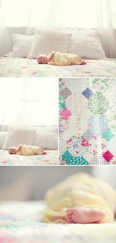 newborn with vintage quilt