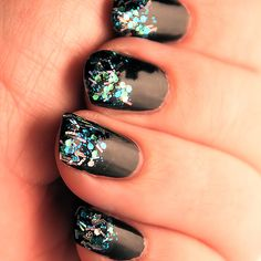 """Sally Hansen Hard As Nails Xtreme Wear """"In the Spotlight"""" with Milani """"Teal"""" glitter polish over the top. Sally Hansen Hard As Nails """"Black Heart"""" as a base :o)    By Eva Bethel"""