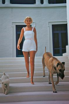 C.Z. Guest + pooch pals by Slim Aarons