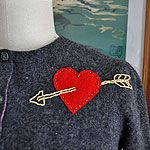 cupid's arrow sweater embellishment