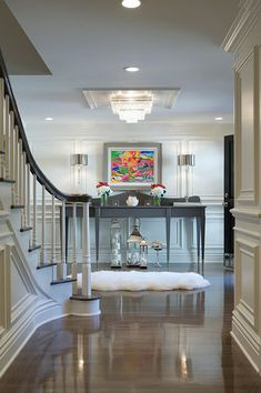 Staircase, mouldings, chandelier Elizabeth Kimberly Design