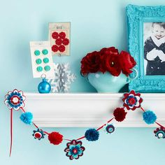 Old-fashioned yarn pom-poms bring the whimsy to this fun and friendly garland: http://www.bhg.com/christmas/garlands/holiday-garland-ideas/?socsrc=bhgpin120913pompomandflowergarland&page=22