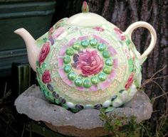 Glossy garden art using bowling balls Becky Norris's teapot bowling ball ??  Yes!
