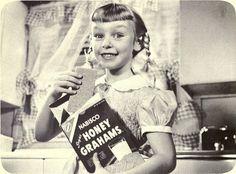 Enjoying a delicious box of Nabisco Honey Grahams, 1957. #vintage #1950s #food #ads