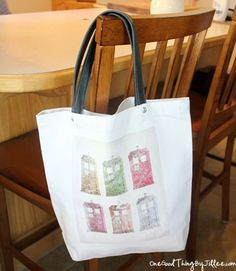 I absolutely love this, and will be making myself one soon....  DIY Canvas Tote Revamp!
