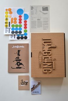 """Kit Jungling by milimbo on Etsy, With this assembling game you can play to create your own jungle. Each """"Jungling Kit"""" consists of a box that includes 6 sheets of cardboard marked with 42 pieces, 5 of these are animals (monkey, giraffe, tiger, elephant and crocodile) pieces to mount a jungle with trees and plants and other parts to assemble a tree hut. Also includes a set of adhesives with different sizes and colors to customize your own jungle and this little book to help you with differgametes"""