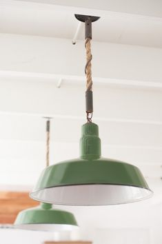 Green industrial pendants light hung with nautical rope | Remodelista from Cisco Home