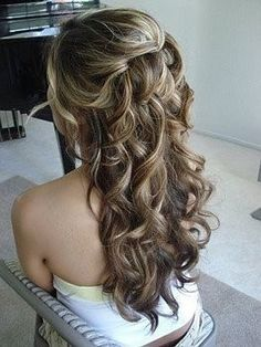"""Curl your hair, then separate the top third of you hair. Divide that into three parts, and twist those sections inward and pin them-- the 2 side ones first and then the middle 3rd section last. Pin your sections using the """"anchoring"""" method. Look it up, this way you can hide bobby pins!"""