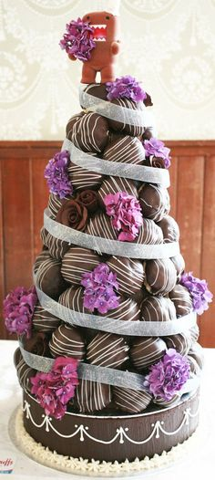 choc Croquembouche with ribbon and purple flowers #food #cake #wedding