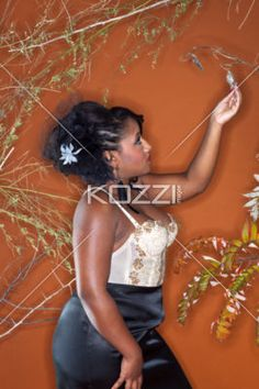 girl reaching for leaf - Young woman wearing formalwear reaching for a leaf. Model: Kayla Creay Hair, MUA and Sylist: DMG Designz - www.dmgdesignz.ca Jewellry Provided by Unique Rainbow
