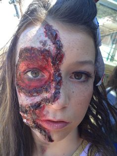 Fun Halloween zombie makeup. Use toilet paper strips dipped in latex to make a cool effect! Love the gel blood that you have to heat up before using! Teeth on the side of face we used fake nails.