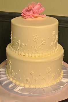 Making a miniature wedding cake for the bridal shower lets you make changes for the big day!