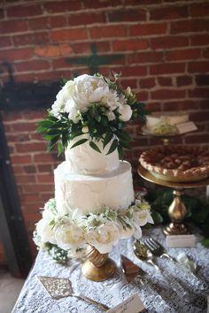 wedding flower topped cake, photo by Ashley Kickliter http://ruffledblog.com/alabama-railyard-wedding #weddingcake #cakes