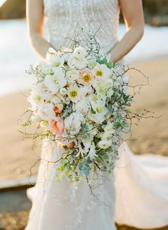 Spectacular Wedding Bouquet Max Gill | Photography: Sylvie Gil | See more on SMP: http://www.StyleMePretty.com/2014/03/11/elegant-beach-wedding-inspiration/