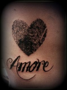 this would be cool if it was the mom and dad's prints...with the child's name underneath  amore thumb prints (his and her tattoo)