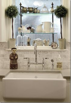 Topiary, pottery, religious imagery and silver.  Love it! faucet, dream kitchen, kitchen windows, topiari, farmhouse sinks, subway tiles, farm sinks, farmhous sink, marbl