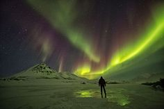 A self-portrait under the northern lights on the Blackstone River along the Dempster Highway on Sunday April 14, 2013