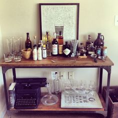 World Market home bar. This is it. Decided. Grandpa's vintage typewriter as well. Barcart, bar cart