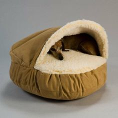 Cave-type bed keeps pets cozy and is the perfect accent to any décor. My Buster would love this!!