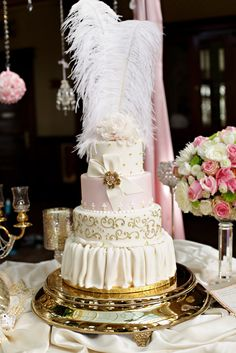 Marie Antoinette style pink and gold wedding cake