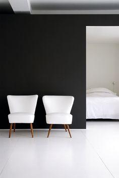 black wall & white furniture