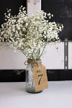 Burlap is still so popular/trendy for weddings! Check out this table number here.