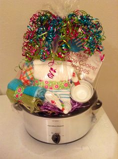 Crock pot filled with items! Might be able to pick up a crock pot cheap on Black Friday or around Christmas.  Add some kitchen towels, measuring cups and crock pot recipes.