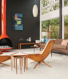 The fireplace was powder-coated orange to complement the vintage furnishings.