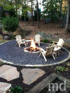 Firepit by Stampin' Up: cut the circle/snail shape into the yard. then laid the paver stones along the edge by the grass and also around the circle for the fire – underneath is something like sand but it had a different name. Then the filler where the chairs are is slate chips – I think there are 4 tons in that area!
