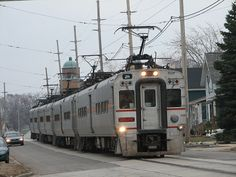 NICT Interurban/commuter train - street running down 11th Street in Michigan City, Indiana