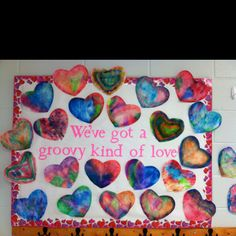 Valentine bulletin board. Use color diffusing paper or coffee filters. Color with washable markers, spray with water,  and blot excess. Looks just like tie dye!