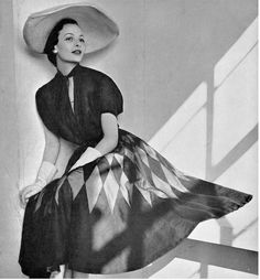 1950, Model in navy blue and pink diamond print organza dress by Jacques Griffe