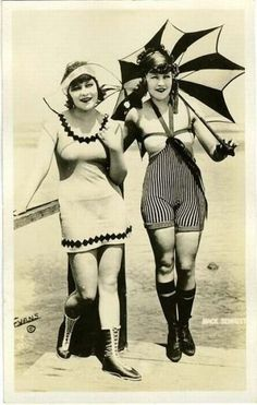 1920's    (knee-highs, stripes, dark lipstick, parasol. Looks like a beach-win to me.)