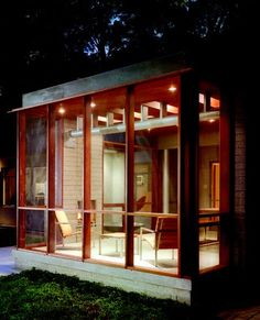 simple screened in porch with fireplace
