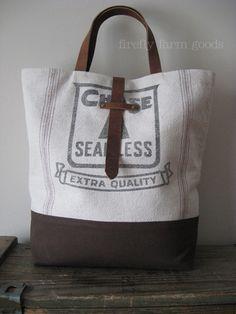 roomy tote with inside pockets.  Canvas grain sack.  Firefly Farm Goods. (Deb)