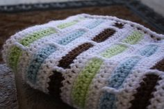 This pattern can be found free on ravelry: http://www.ravelry.com/patterns/library/crochet-stripe-blanket